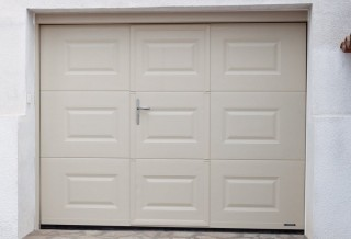 Photo - Garage Door with Window Panes and Wicket Door