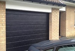Photo - Wood Grain Finish Single-Grooved Garage Door