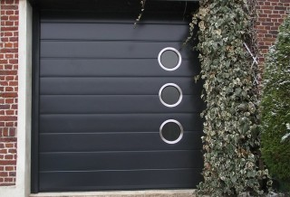 Photo - Mono-Grooved Garage Door with Round Stainless Steel Windows