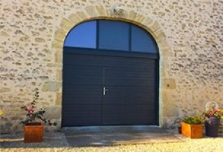 Photo - Grooved Garage Door with Wicket Door