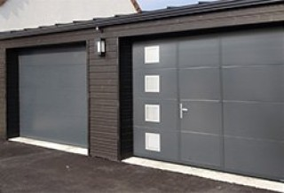 Photo - Smooth Garage Door with Wicket Door